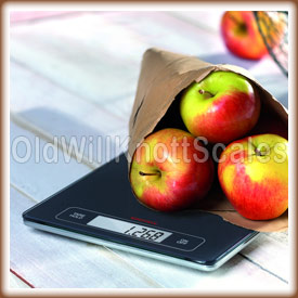 The Page Profi weighing a bag of apples.