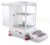 Ohaus - EX125D - With doors open, weight on platform and tweezers on the shelf